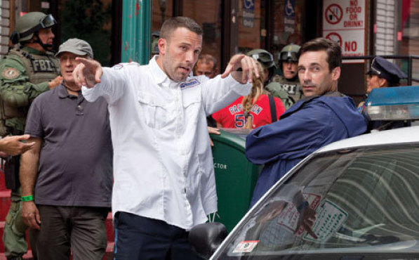 BEN THERE, DO THAT Affleck, center, offers Jon Hamm, right, a few Bostonian tips.