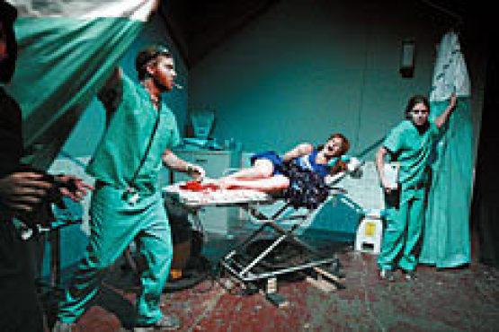 FETUS DON'T FAIL ME NOW Pregnant cheerleader Julie Klausner, center, has a medical emergency.