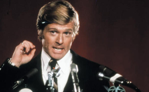 THE STUMP-DANCE KID Redford makes campaign promises in The Candidate.
