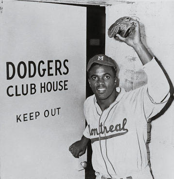 OPPORTUNITY KNOCKS Robinson stepsthrough the Dodgers' clubhouse doorand into history.