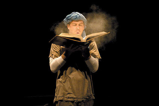 TOME DELIVERY Rauch blows the dust off an ancient book.