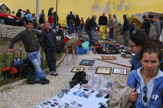 Go shopping at Feira da Ladra in Lisbon, Portugal
